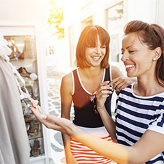 Two women smiling while shopping